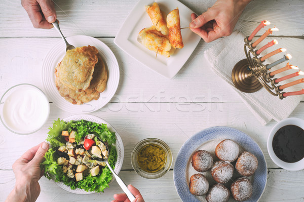 Hanukkah dinner with traditional dishes on the white wooden table Stock photo © Karpenkovdenis