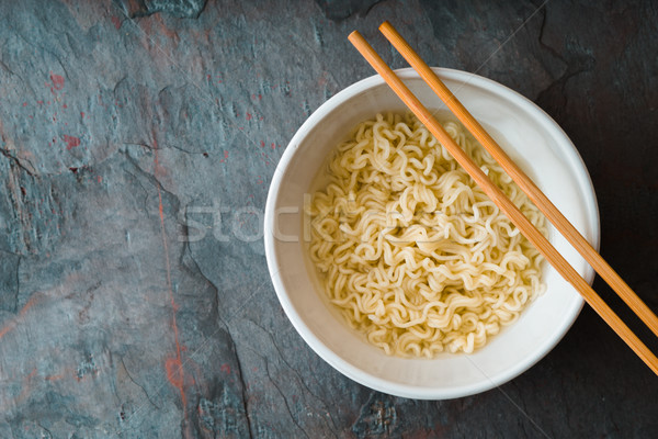 Soup Ramen noodles in ceramic bowl and bamboo sticks Stock photo © Karpenkovdenis