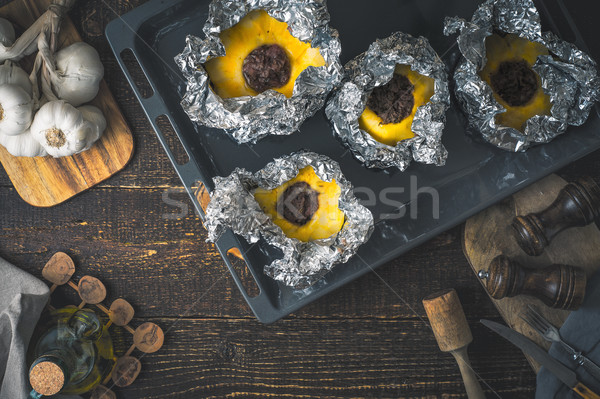 Stuffed pattypan on the  backing sheet on the wooden table Stock photo © Karpenkovdenis