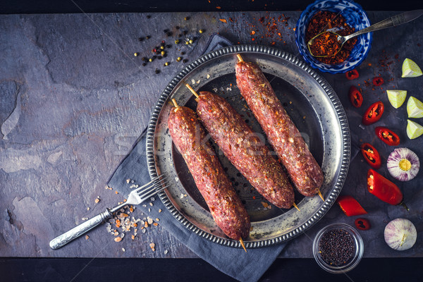 Raw kebabs with seasoning on the stone table top view Stock photo © Karpenkovdenis