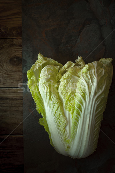 Chinese cabbage on a gray slate on old boards Stock photo © Karpenkovdenis