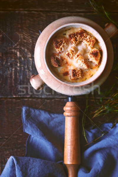Ceramic pot with onion soup on the wooden table Stock photo © Karpenkovdenis