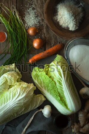 Frame with Chinese cabbage and ingredients for kimchi on a wooden table Stock photo © Karpenkovdenis