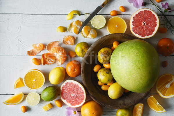 Stock photo: Citrus mix on the white wooden table  top view