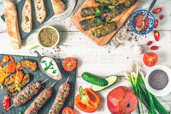 Kebabs with dolma, seasoning and vegetable. Concept Middle east , Asian and Caucasian cuisine top vi Stock photo © Karpenkovdenis
