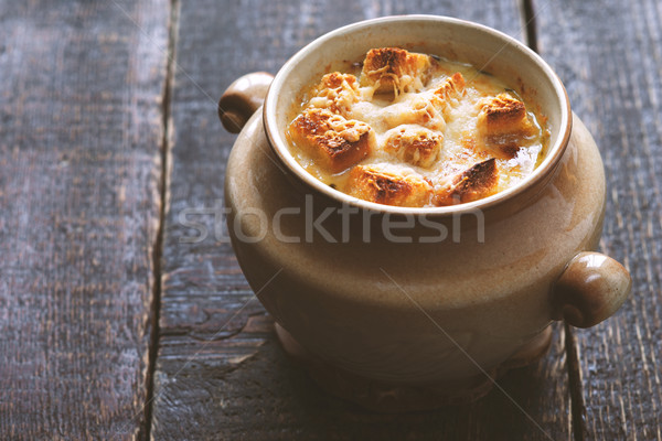 Onion soup in the ceramic pot on the wooden table horizontal Stock photo © Karpenkovdenis
