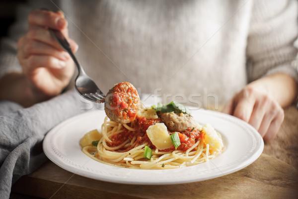 Woman eating meatballs Stock photo © Karpenkovdenis