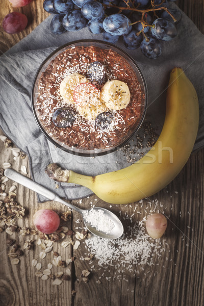 Chocolate chia pudding with fruits on the wooden table  top view Stock photo © Karpenkovdenis