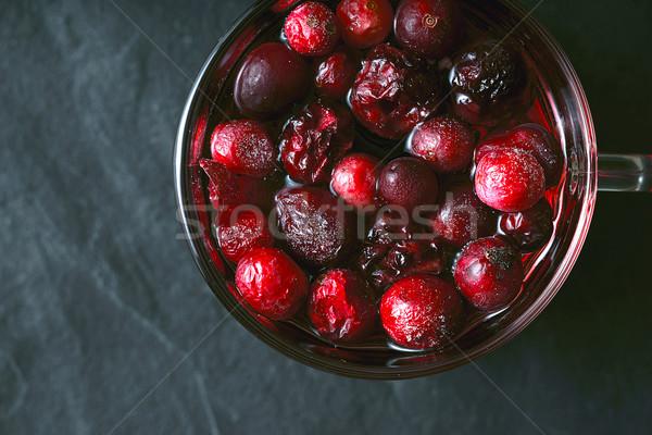 Cup tè frutti di bosco buio pietra tavola Foto d'archivio © Karpenkovdenis