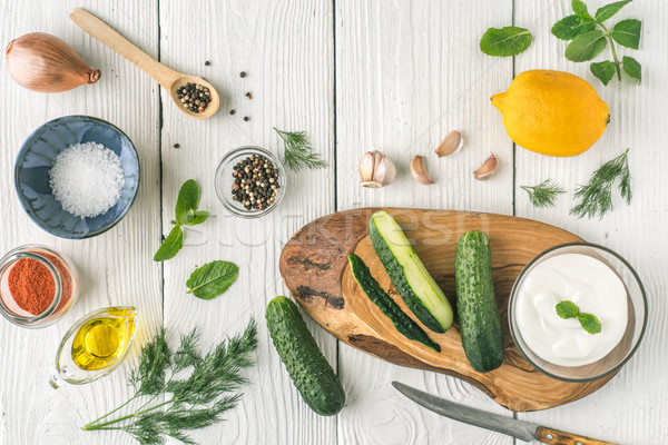Ingredients for tzatziki preparation on the white  table top view Stock photo © Karpenkovdenis