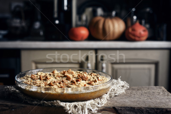 Raw pumpkin dump cake in the baking dish on the wooden table Stock photo © Karpenkovdenis