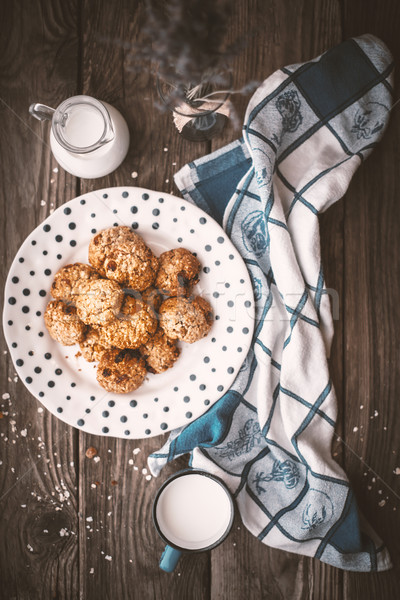 Pitcher, lavender, oatmeal cookies and a cup of milk on old boar Stock photo © Karpenkovdenis