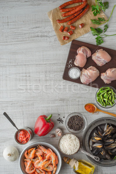 Stock photo: Ingredients for paella on the white  wooden table vertical