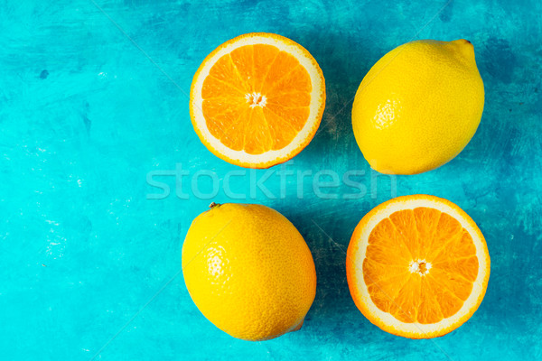 Lemons and oranges on the cyan background top view Stock photo © Karpenkovdenis
