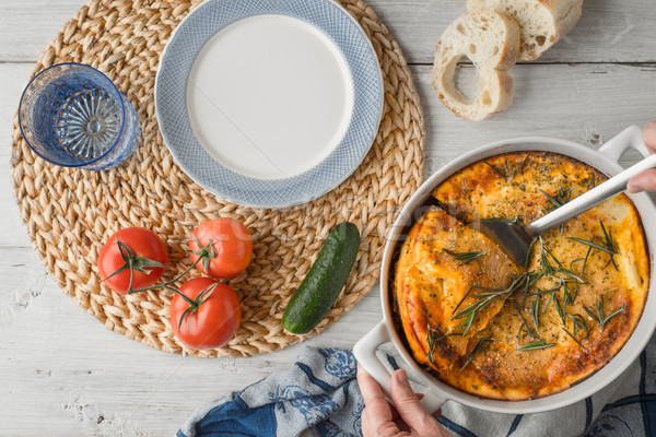 Stock photo: Moussaka in the white table with tableware and vegetables top view