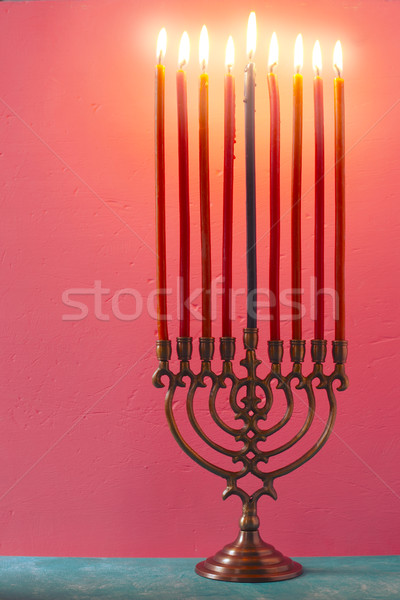 Hanukkah menorah with burning candles on the pink background vertical Stock photo © Karpenkovdenis