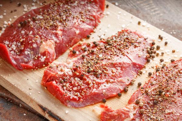 Fresh beef steak and spicel on the wooden board Stock photo © Karpenkovdenis