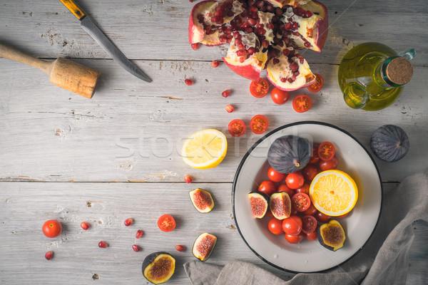 гранат помидоры черри белый деревянный стол Top мнение Сток-фото © Karpenkovdenis