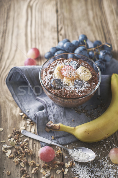 Chocolate chia pudding with fruit in the glass bowl vertical Stock photo © Karpenkovdenis