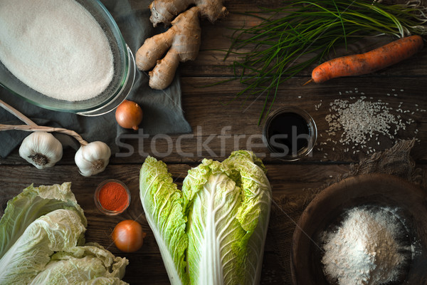 Chinese cabbage kimchi and ingredients on a wooden table Stock photo © Karpenkovdenis