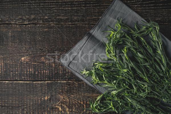 Tarragon on the grey napkin on the wooden table top view Stock photo © Karpenkovdenis
