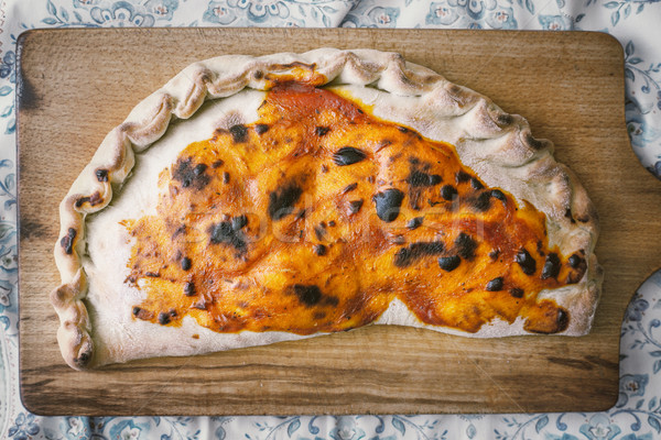 Calzone on the wooden board top view Stock photo © Karpenkovdenis