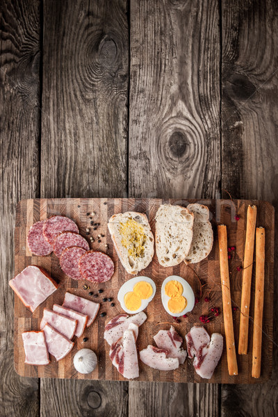 Eggs, ham, sausage, bread, pepper, garlic on a cutting board  Stock photo © Karpenkovdenis
