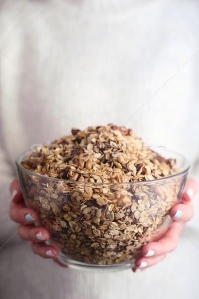 Vidrio tazón granola mujer manos mano Foto stock © Karpenkovdenis