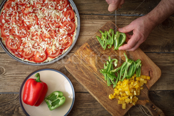 Stock photo: Pizza baking form and sliced pepper on the table