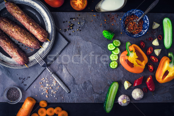 Kebabs with seasoning and vegetable. Concept Middle east , Asian and Caucasian cuisine Stock photo © Karpenkovdenis