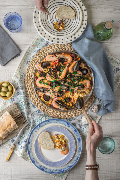 Eating paella on the table with beautiful napkin top view Stock photo © Karpenkovdenis