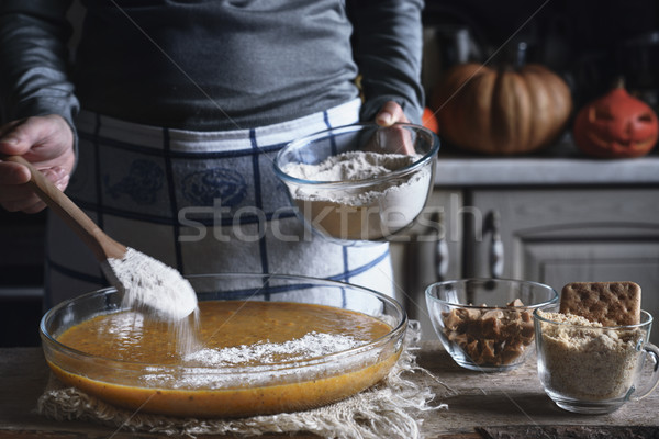 Adding flour in the dough for dump cake  in the baking dish Stock photo © Karpenkovdenis