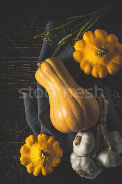 Pumpkin , patty pans and garlic on the old wooden table top view Stock photo © Karpenkovdenis