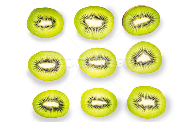 Pattern of kiwi slices on the white background Stock photo © Karpenkovdenis