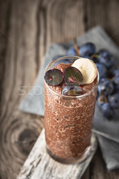 Csokoládé puding gyümölcs üveg fa asztal egészség Stock fotó © Karpenkovdenis