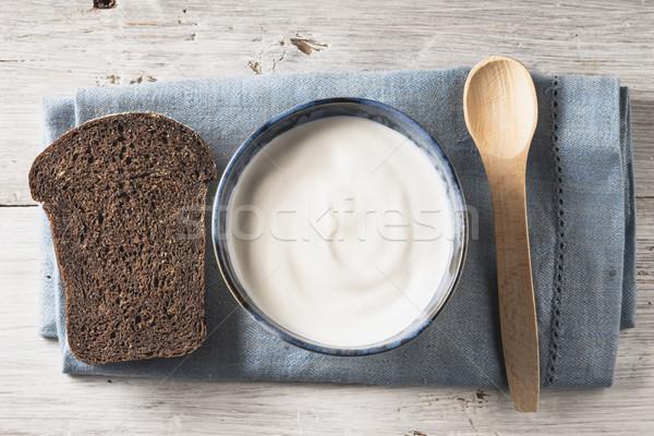 сметана керамической блюдо хлеб белый деревянный стол Сток-фото © Karpenkovdenis