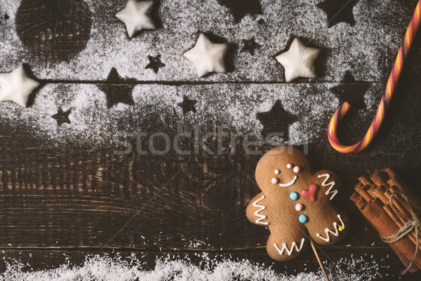 Christmas composition with gingerbread man on the wooden table top view Stock photo © Karpenkovdenis