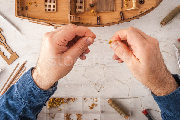 Man collects ship model on a white table  Stock photo © Karpenkovdenis