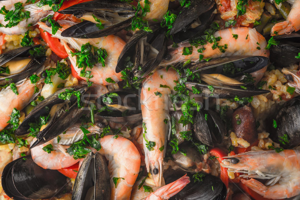 Paella with seafood  and greens background close-up Stock photo © Karpenkovdenis