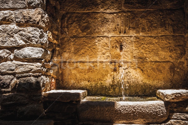 小 噴水 石の壁 水 太陽 背景 ストックフォト © Karpenkovdenis