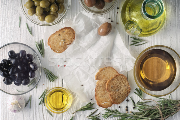 Olive oil with  bread and olives mix on the white wooden table horizontal Stock photo © Karpenkovdenis