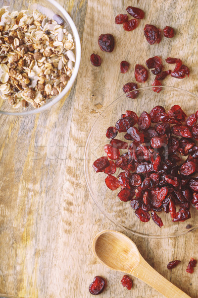 Dried cranberries in the glass bowl on the wooden table top view Stock photo © Karpenkovdenis