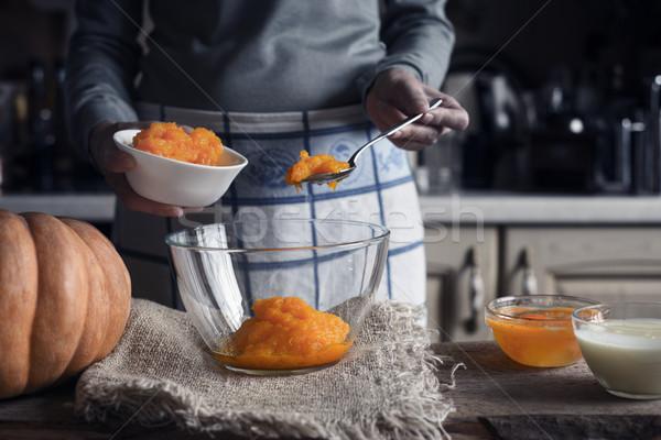 Putting pumpkin puree in the glass bowl Stock photo © Karpenkovdenis