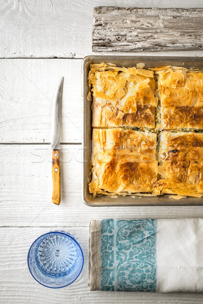 Greek pie spanakopita in the metal pan  with table ware vertical Stock photo © Karpenkovdenis