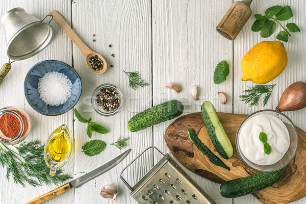 Ingredients for tzatziki preparation on the white  wooden table  top view Stock photo © Karpenkovdenis
