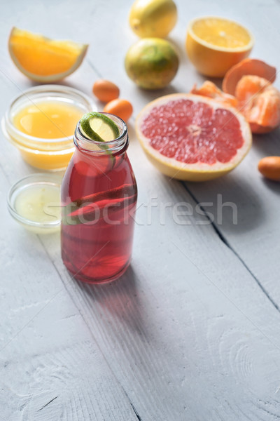 Fitness citrus cocktail on the white wooden table vertical Stock photo © Karpenkovdenis