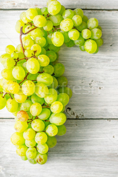 Grapes on the white wooden table vertical Stock photo © Karpenkovdenis