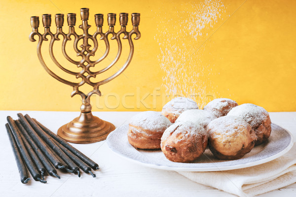 Hanukkah menorah and sufganiot on the table horizontal Stock photo © Karpenkovdenis