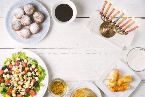 Traditional Hanukkah  dishes on the white wooden table Stock photo © Karpenkovdenis