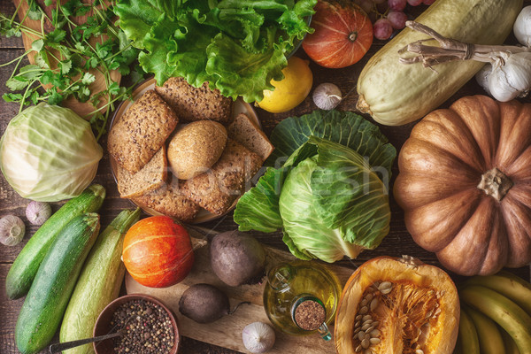 Grain bread with different vegetable on the wooden table top view. Concept of healthy food Stock photo © Karpenkovdenis